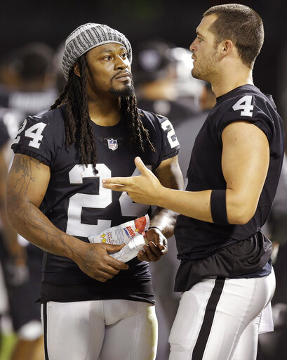Marshawn Lynch, Derek Carr