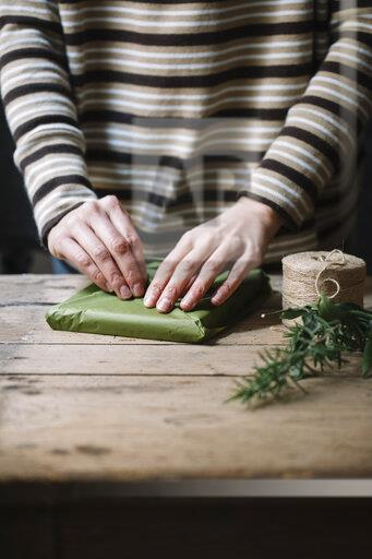Woman's hands wrapping present