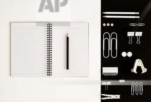 White office utensils on black background and notepad and pencil on whilte background
