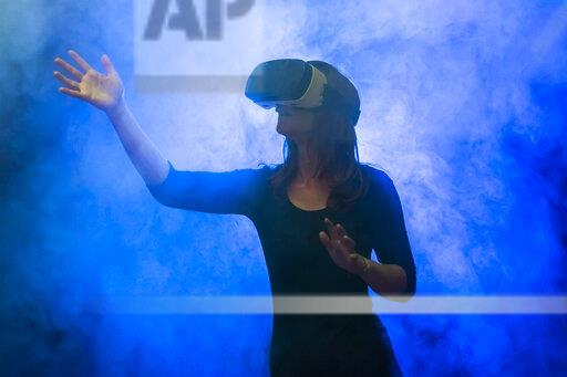 Woman with virtual reality glasses in the fog