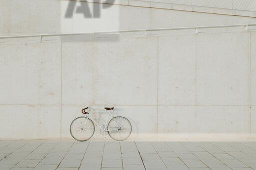 Vintage bicycle leaning on concrete wall