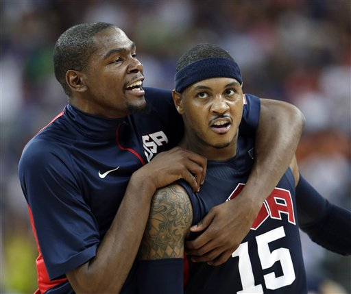 United States' Kevin Durant, left, celebrates with teammate Carmelo