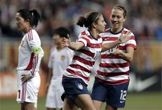 Carli Lloyd, Lauren Cheney