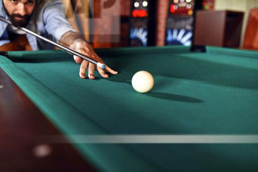 Close-up of man playing billiards