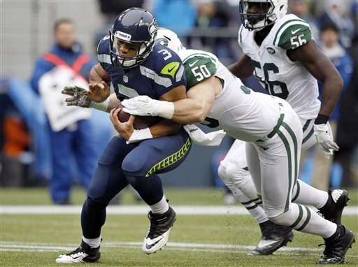 Russell Wilson, Garrett McIntyre