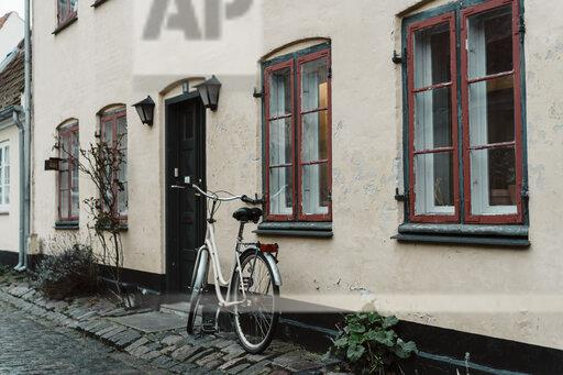 Denmark, Dragor, bicycle parked in front of residential house