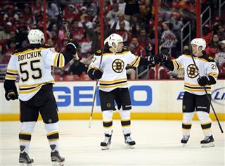 Milan Lucic, Andrew Ference, Johnny Boychuk