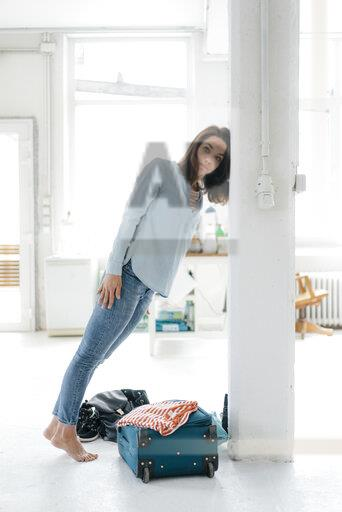 Jet-legged woman leaning on pillar