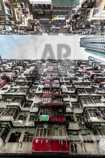 Hong Kong, Quarry Bay, apartment blocks contrasting with modern skyscraper