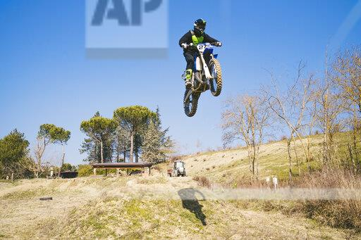 Motocross driver jumping on circuit