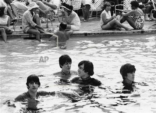 Music Rock Group The Beatles Swimming Pool Clothed Beatles In Pool Buy Photos Ap Images