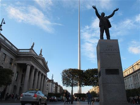 In this picture taken on Monday, Oct. 6, 2014, Dublin's colonnaded General Post Office is seen, left, a national monument to Ireland's independence fight. The Irish nationalist Sinn Fein party is seeking to triumph in Ireland's next elections expected in 2016, the 100th anniversary of an Easter Rising against British rule that rebel commanders directed from the post office. A new poll has made Sinn Fein as popular as the main Irish government party for the first time.