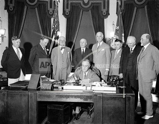 Watchf AP A F DIST. OF COL USA APHS85033 FDR Signs Securities Bill 1933