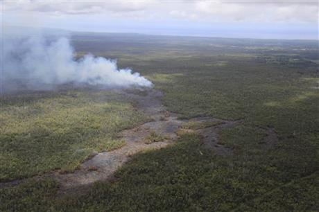 This Monday, Sept. 8, 2014, aerial photo provided by the U.S. Geological Survey shows a smoke plume from the June 27th flow from the Kilauea volcano in Pahoa, Hawaii. Lava from one of the world's most active volcanos has been advancing at a slower pace the past few days and is now moving parallel to a sparsely populated subdivision on Hawaii's Big Island. (AP Photo/U.S. Geological Survey, Tim Orr)