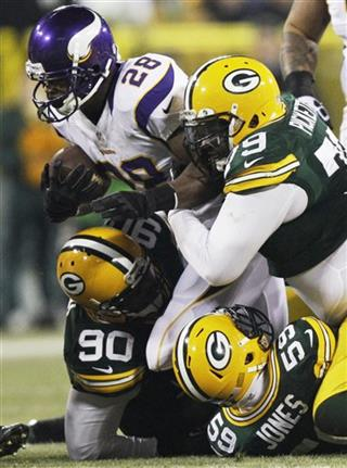 Adrian Peterson, B.J. Raji, Ryan Pickett, Brad Jones