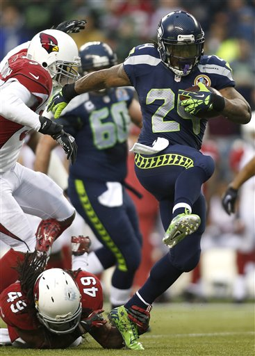 Marshawn Lynch, Rashad Johnson, Daryl Washington