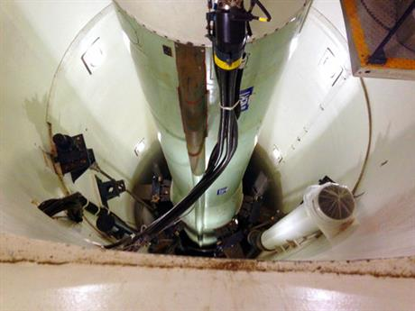 This Jan. 9, 2014, file photo shows a mockup of a Minuteman 3 nuclear missile used for training by missile maintenance crews at F. E. Warren Air Force Base, Wyo. The Air Force is quietly shrinking its deployed force of long-range nuclear missiles as part of a holdover Obama administration plan to comply with an arms control treaty with Russia, The Associated Press has learned. The plan is proceeding despite President Donald Trump's argument that the deal gave Moscow an unfair advantage in strategic nuclear firepower. (AP Photo/Robert Burns, File)