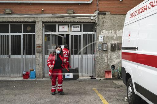 Red Cross members of San Donato Milanese offer service in Milan, Italy - 27 Mar 2020