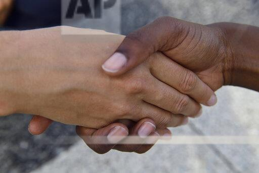 Close-up of two women shaking hands