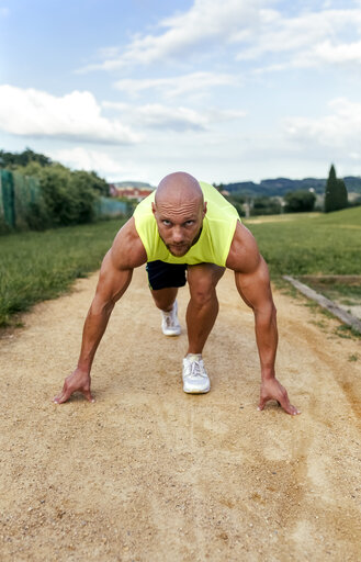 Muscular man in starting position