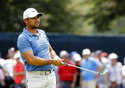 Jason Day, of Australia, watches his shot from the first fairway during the final round of the PGA Championship golf tournament at Bellerive Country Club, Sunday, Aug. 12, 2018, in St. Louis. (AP Photo/Brynn Anderson)