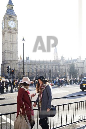 UK, London, two women in the city near Big Ben