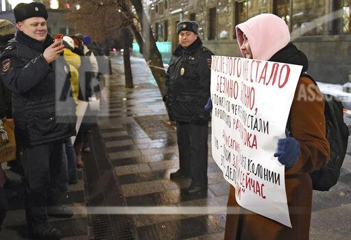 One person protests demanding the release of political prisoners in the Network case near the FSB building on Lubyanka.