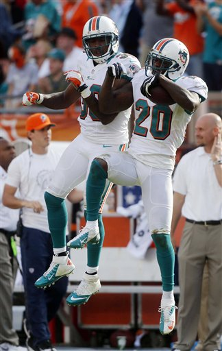 Chris Clemons, Reshad Jones