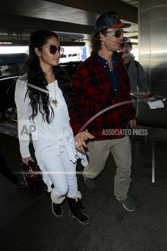 VNTGE Vantagenews.com/IPx A ENT  USA IPx Matthew McConaughey is seen arriving at LAX Airport to catch a flight with his wife Camila Alves.