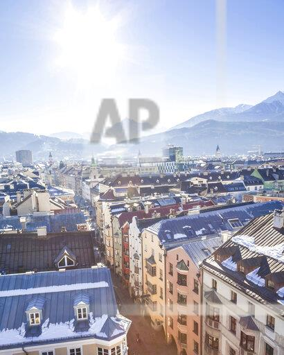 Austria, Tyrol, Innsbruck, Panoramic views of the city with snow-capped Alps in background