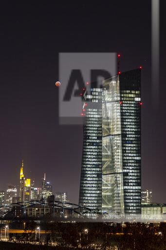 Germany, Frankfurt on Main, view to European Central Bank and lighted city skyline at total lunar eclipse