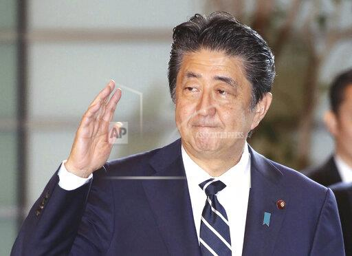 Correction: Japan's PM Shinzo Abe arrives at prime minister's of