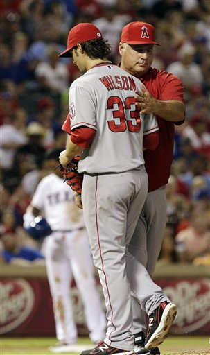 C.J. Wilson,  Mike Scioscia