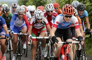 Cyclists compete during the women&#039;s cycling road race final at the London 2012 Olympic Games