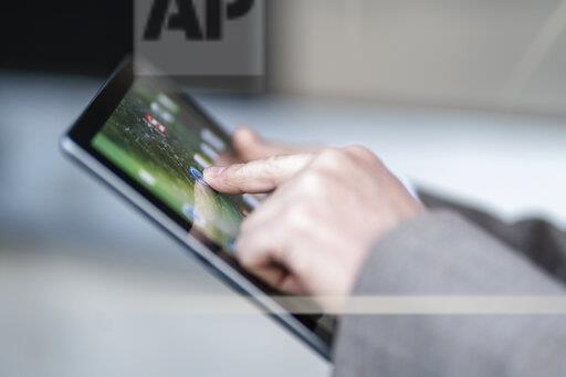 Close-up of businessman using tablet