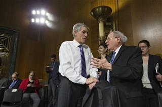 Carl Levin, Mark Udall