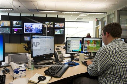 Creative Robert Harding Productions /AP Images A  Oklahoma United States of America 465-3149 Jonathan Kurtz, forecaster and meteorologist at the National Weather Center Forecast Office in Norman, Oklahoma, United States o