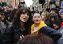 FILE - In this March 8, 2018 file photo, actresses Asia Argento, left, and Rose McGowan pose during a demonstration to mark the international Women's Day in Rome. Argento, one of the most prominent activists of the #MeToo movement against sexual harassment, recently settled a complaint filed against her by a young actor and musician who said she sexually assaulted him when he was 17, the New York Times reported. (AP Photo/Alessandra Tarantino, File)