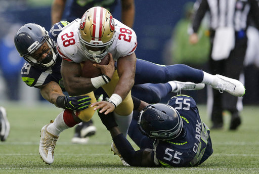 c0687483a Wilson s escape act helps Seahawks top 49ers 12-9
