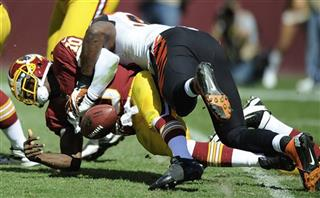 Michael Johnson,  Robert Griffin III