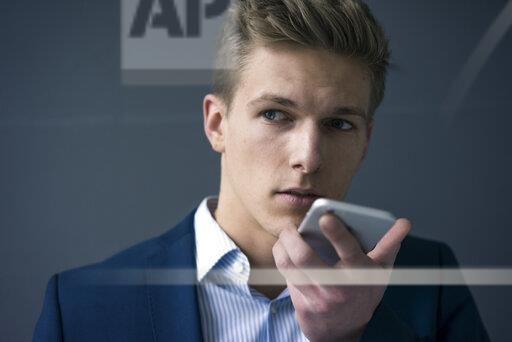 Portrait of young businessman using smartphone