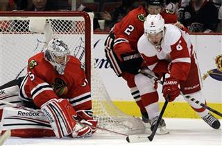 Justin Abdelkader, Duncan Keith, Corey Crawford