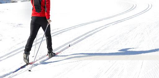 Austria, Tyrol, Achensee, close-up of man doing cross country skiing