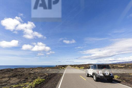 USA, Hawaii, Volcanoes National Park, lava fields, off-road vehicle on the Chain of Craters Road
