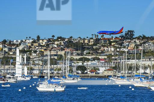 USA, California, San Diego, Airplane and sailing boats