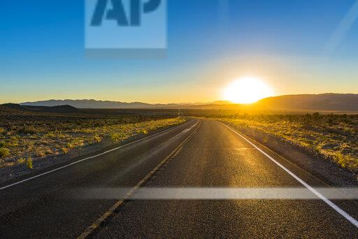 USA, Nevada, Long winding road at sunset