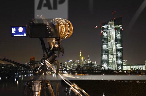 Germany, Frankfurt on Main, view to European Central Bank at total lunar eclipse with camera in the foreground
