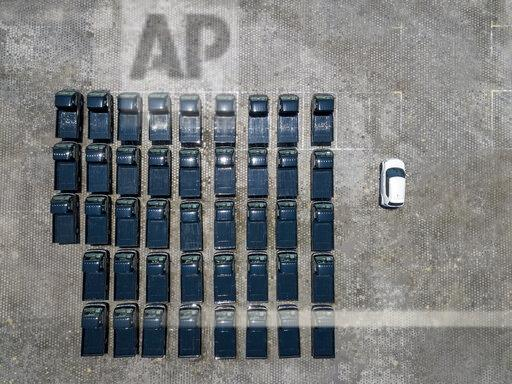 Indonesia, Bali, Aerial view of car park, one white car next to black