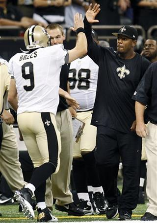 Jonathan Vilma, Drew Brees