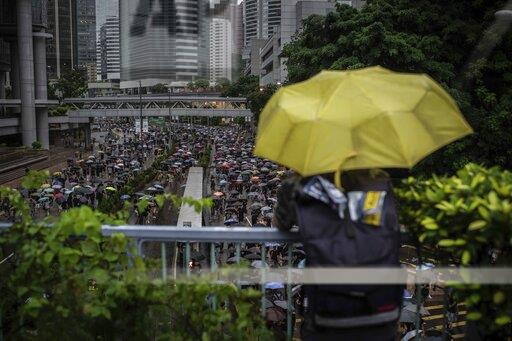 Extradition bill protests on a rainy day in Hong Kong, China - 18 Aug 2019